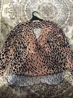Leopard print size 8 high low top