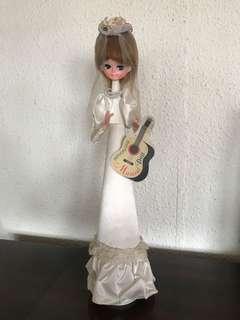 Vintage Revolving Musical Doll