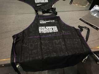 Redken apron purple and black