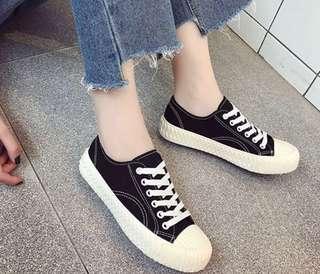 黑色餅乾帆布鞋