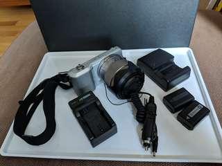 Sony NEX-3K Digital Camera 14.2MP w/18-55mm F3.5-5.6 Interchangeable Lens |  Silver (Charger, USB Connector, 16 GB Memory Card, M0851 camera bag)