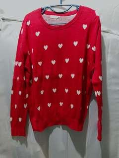 Red sweater with white hearts prints