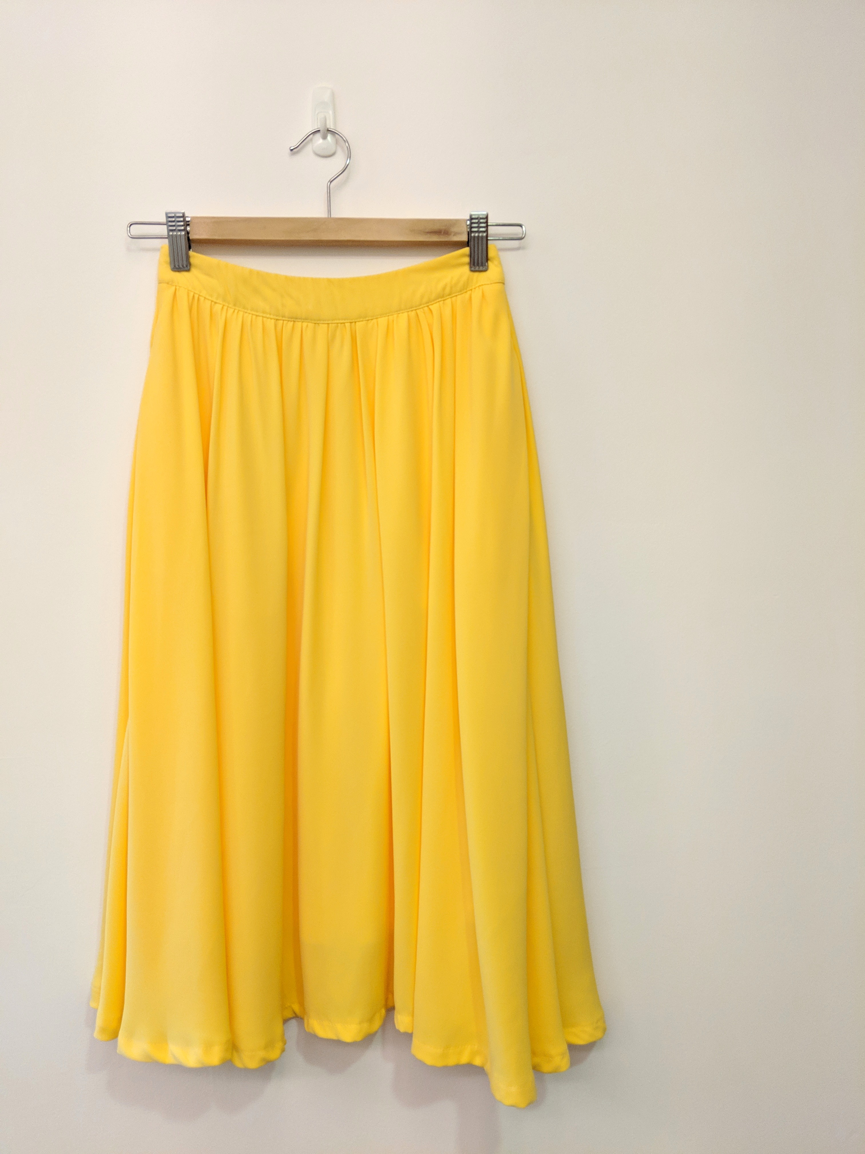 e10bb86013 [The Tinsel Rack] Yellow Midi Skirt, Women's Fashion, Clothes, Dresses &  Skirts on Carousell