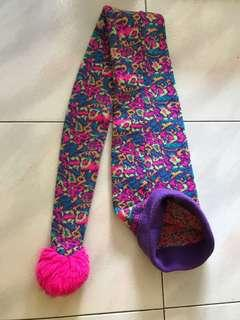 Multi coloured knitted winter hat and scarf