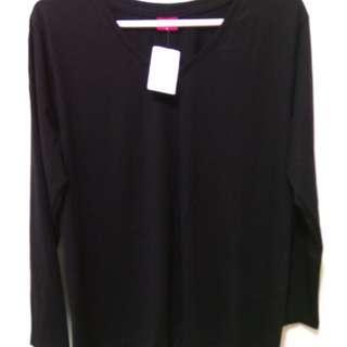 Plus size black pullover top