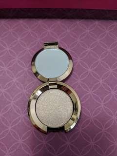 Becca's mini opal highlighter