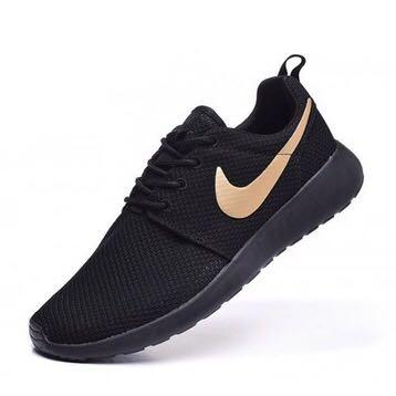 black nike shoes with pink tick