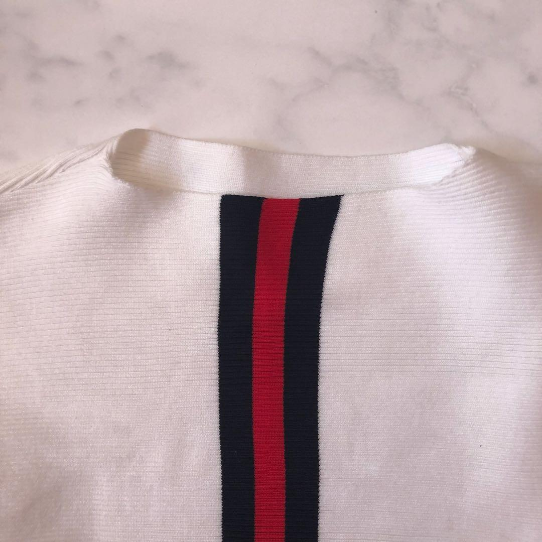White long sleeve top with red black stripes