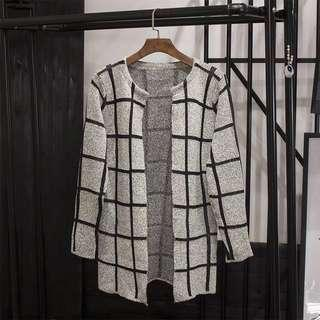 Oversized outerwear in grey