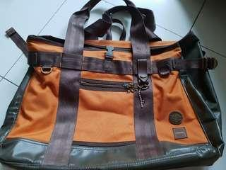 Porter orange and bronze bag