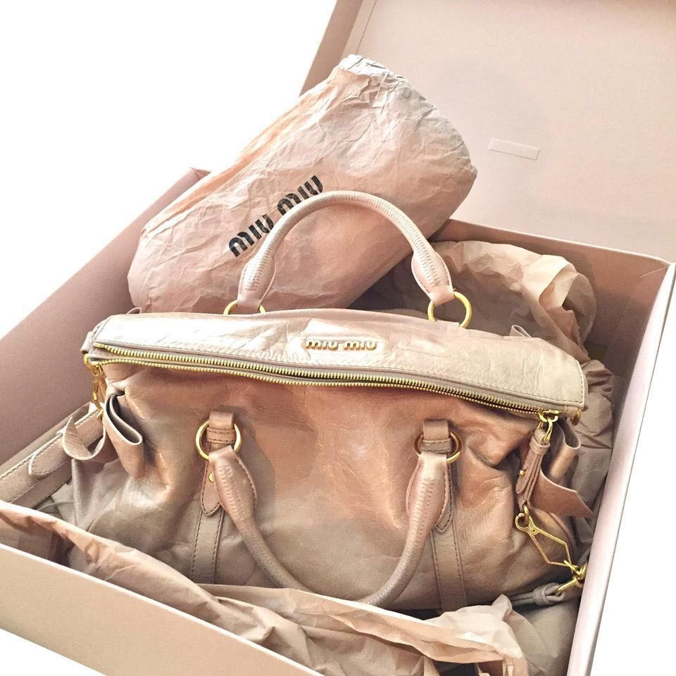 1618eec36020 Authentic Miu Miu Vitello Lux Leather Bow Bag in pink