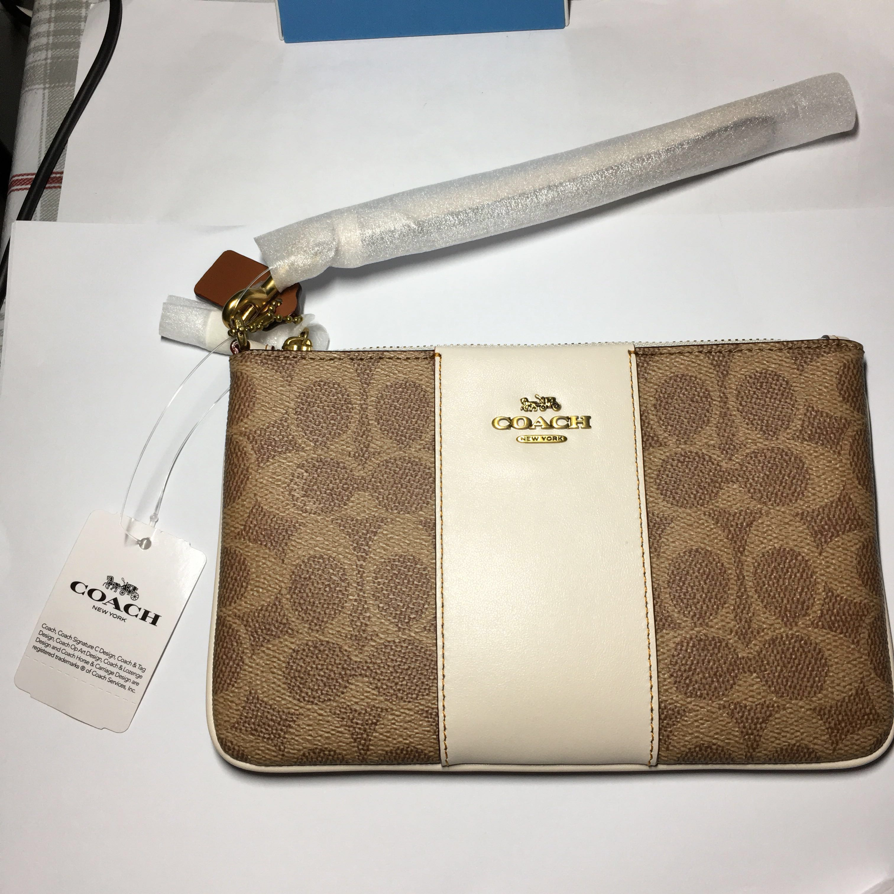 a7f8d935a SMALL WRISTLET IN COLORBLOCK SIGNATURE CANVAS, Luxury, Bags & Wallets,  Wallets on Carousell