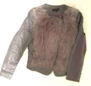 grey fur on leather biker