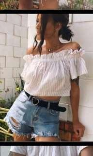 Denim distressed shorts and belt