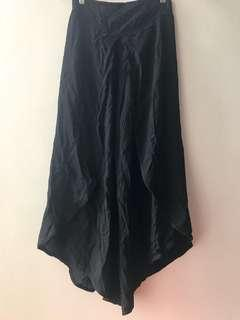 Firm on price.  Excellent condition black garterized cullottes - fits s up to medium