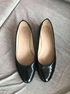 Firm on the price.  Very good condition authentic Ferragamo black patent flats -5.5d