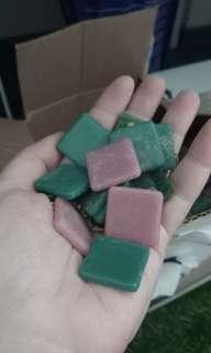 Loose green and pink mosaic tiles