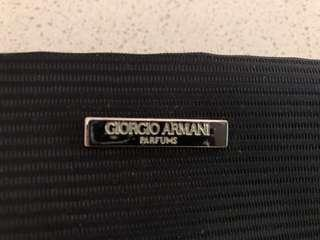 Armani branded toiletry bag.