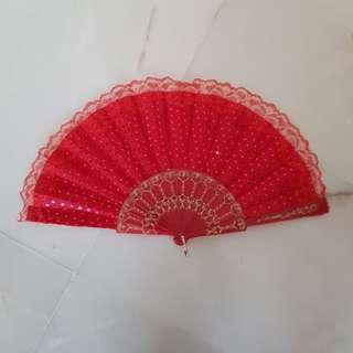 Red fan with lace trimming