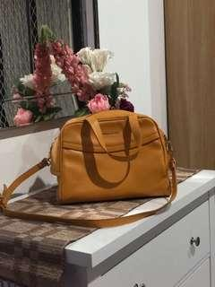 Charles and Keith yellow mustrad