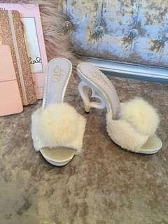 DreamV white fluffy Pom Pom mules with heart shaped heel pin up
