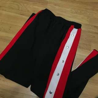 Sporty track pants button side