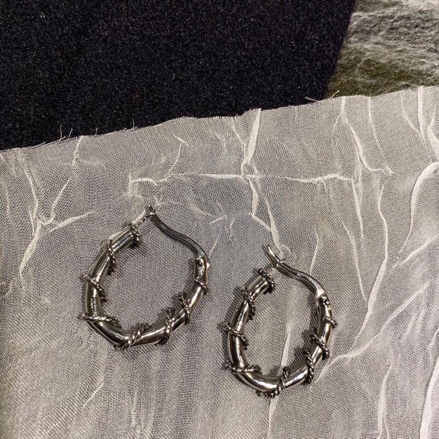 po: barbed hoop earrings