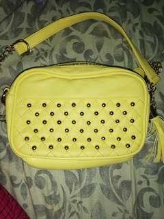 Yellow tassel sling bag