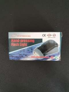 Hand Pressing Flash Light
