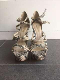 Tan/ black genuine snake leather heels