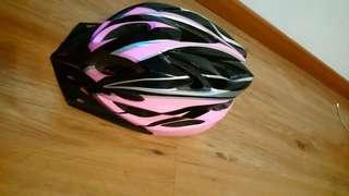 women pink bicycle helmet