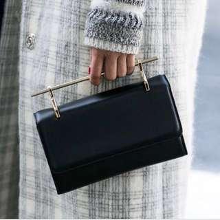 M2malletier Norma Clutch/Sling bag in Black