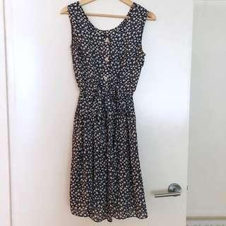 Vintage floral dark blue and white dress with ribbon tie and buttons