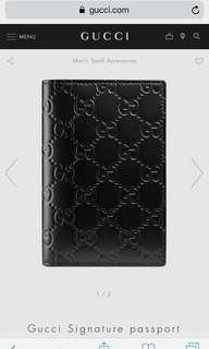 Gucci embossed leather passport holder