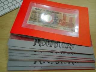 Lot of 18 folders Singapore $50 Dollars 1990 commemorative with date UNC