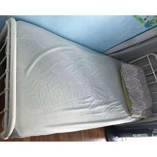White metal frame single bed with mattress