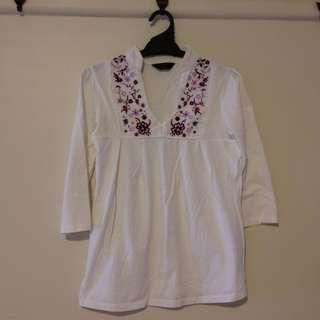 White floral 3/4 top with deep v neck shirt