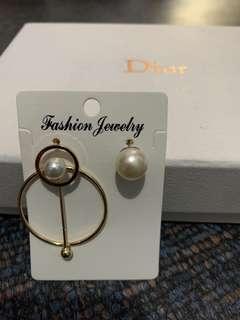 Uneven earrings 1