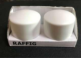 RAFFIG - A pair of white finials