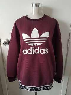 Maroon Adidas jumper with band at bottom. Large