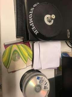 Black CDs and DVDs with paper sleeves and CD sticker alignment machine