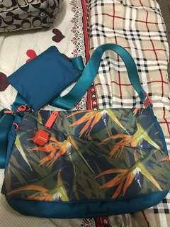 Hedgren sling bag with small wallet inside
