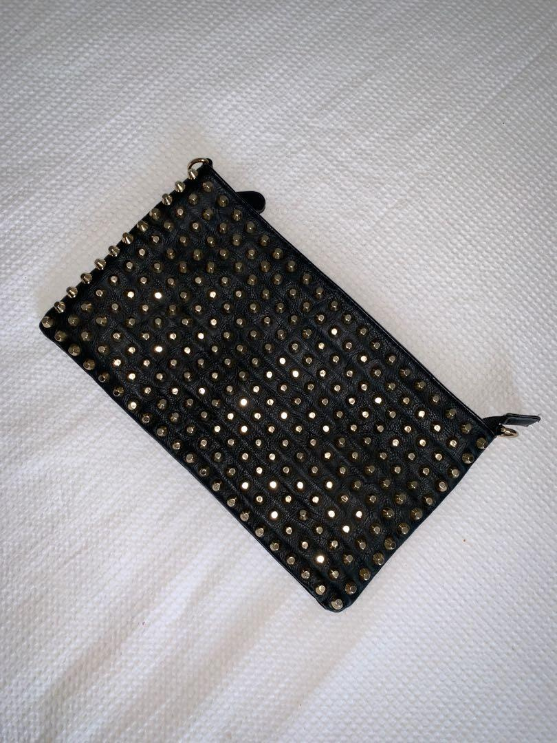 Gold studded clutch