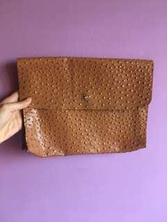 Ostrich leather clutch