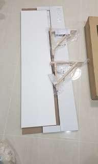 Brand new ikea shelf with slight line crack