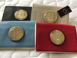 Clutch bags with long strap for sling