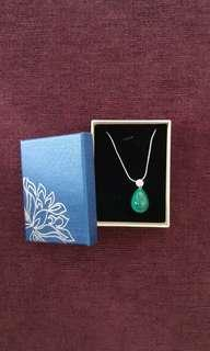 Emerald coloured pendant with crystal