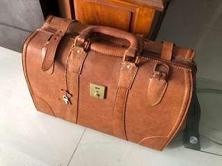 Leather deco luggage