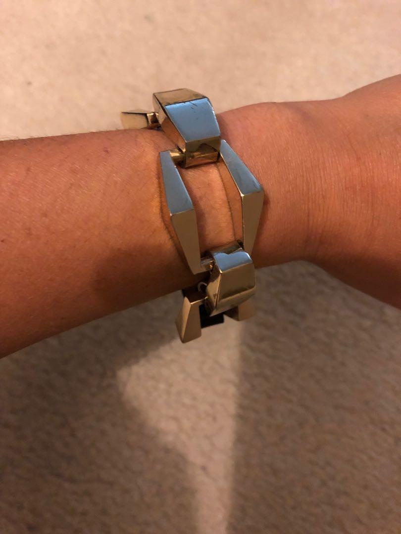 Amarni Exchange gold and leather bangle