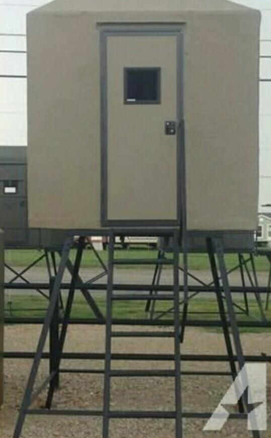 DEER STAND WITH ENCLOSED BLDG.